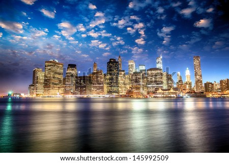 Spectacular sunset view of lower Manhattan skyline from Brooklyn Bridge Park. - stock photo