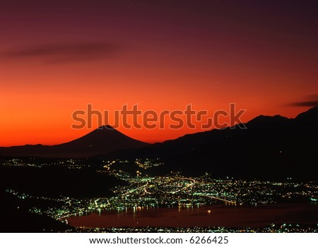 Spectacularly glowing red sky over Mount Fuji - stock photo