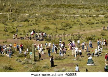 Spectators and participants in a civil war battle enactment. - stock photo