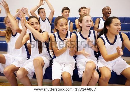 Spectators Watching High School Basketball Team Match - stock photo