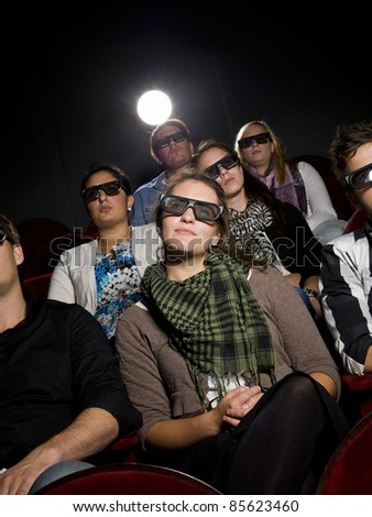 Spectators with 3d glasses on the movie theater - stock photo