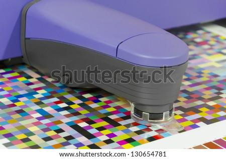spectrophotometer measures color patches on Test Arch, Press shop prepress department - stock photo