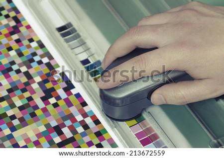 spectrophotometer verify color patches value on Test Arch, Press shop prepress department VINTAGE - stock photo