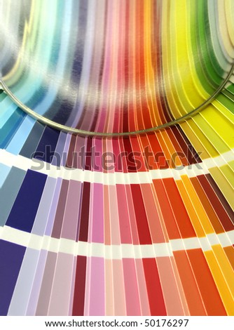 Spectrum of color chart samples and paint can reflection - stock photo