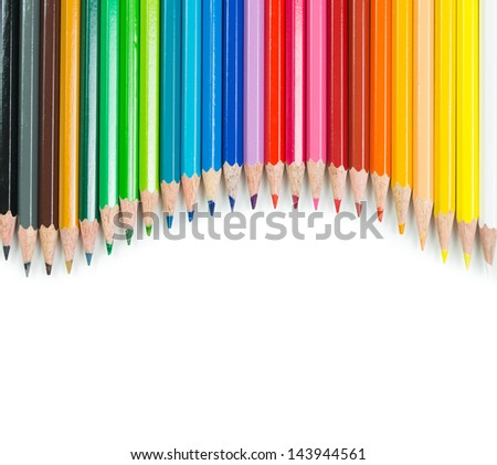 Spectrum of color pencils with white copyspace - stock photo