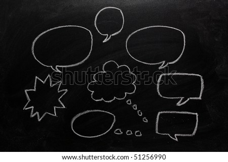 Speech and thinking bubbles drawn on a blackboard - stock photo