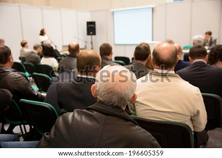 Speech at the conference hall. People at conference hall, rear view - stock photo