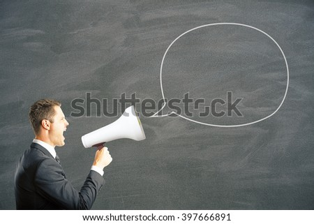 Speech bubble and caucasian businessman shouting into megaphone. Mock up - stock photo