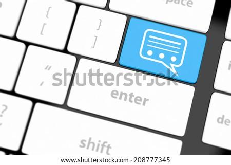 Speech bubble key button on the keyboard. - stock photo
