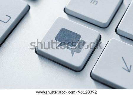 Speech bubble key button on the keyboard. Toned Image. - stock photo