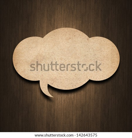 speech bubble paper on wood background - stock photo