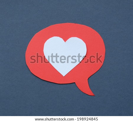 Speech Bubble with the heart. Concept of love. Cut from colored paper.