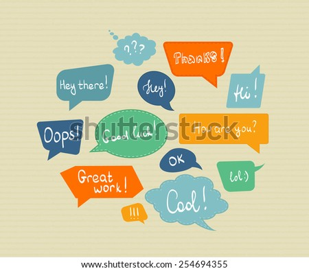 Speech bubbles in different colors isolated on textured paper - stock photo