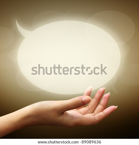 speech bubbles on woman hand on brown background - stock photo