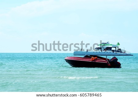 Speed and tourist boat wait for the crews