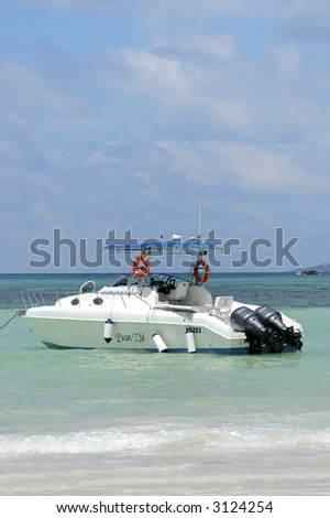 Speed boat in lagoon of tropical island - stock photo