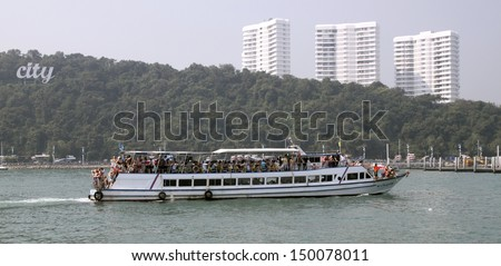 speed boat in the sea at the background of the city Pattaya - stock photo