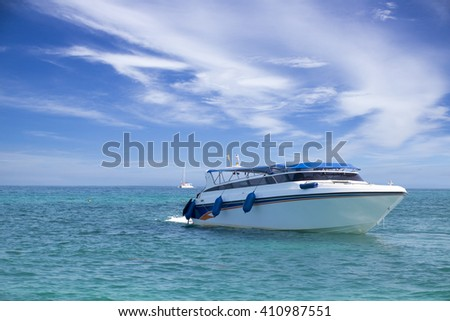speed boat in tropical sea with sky - stock photo