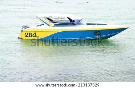 speed boat on sea at koh larn island thailand - stock photo