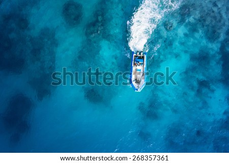 Speed boat on the azure sea. - stock photo