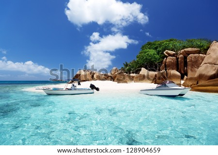 speed boat on the beach of Coco Island, Seychelles - stock photo