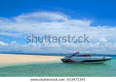 Speed boat on the sea And white sandy area. with beautiful bright sky One island in Koh Samet, Thailand.