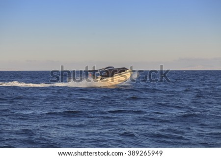 Speed boat sailing in the summer sea in Greece - stock photo
