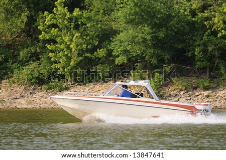 Speed Boating in a vintage boat on a small lake in Kentucky, USA