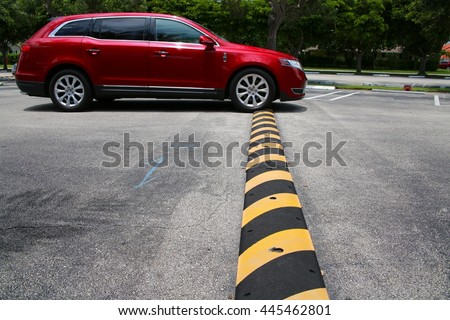 Speed Bump Car Driving Over - stock photo