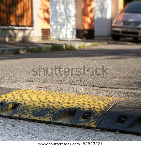 Speed bump in a local street - stock photo