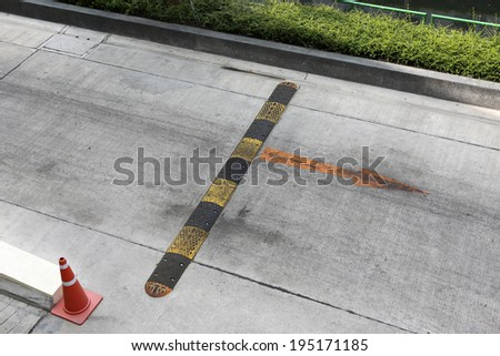speed bump or obstacle on the road to reduce vehicle speed - stock photo