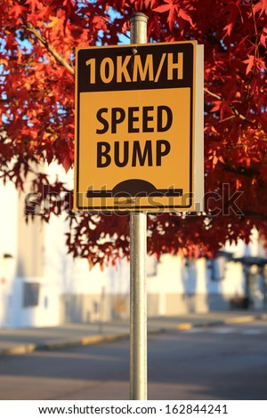 Speed bump road sign - stock photo