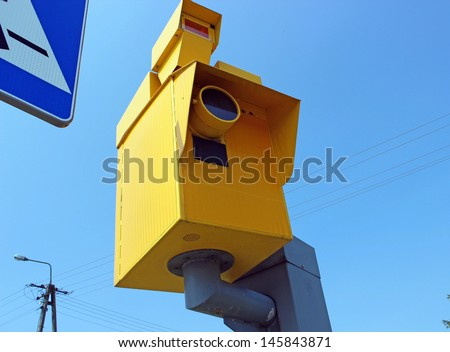 Speed camera and Traffic Light on Green against a Blue Sky - stock photo