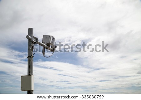 Speed camera box, on blue sky  background with clipping path - stock photo