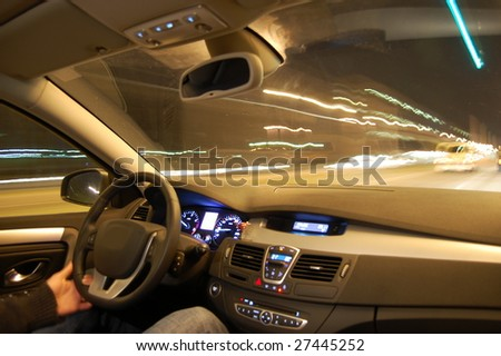 speed car at night in motion with traffic - stock photo