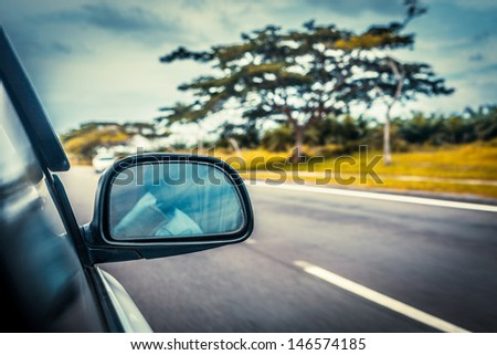 speed car driving at high speed on empty road - motion blur - stock photo