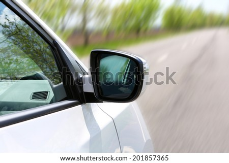 Speed. Car driving on road - stock photo