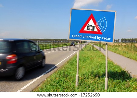 Speed checked by radar roadsign in rural landscape and speeding car with motion blur - stock photo