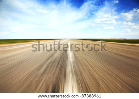 Speed concept. Empty countryside old road stretches in perspective.