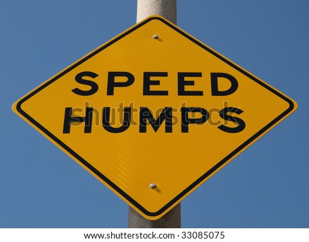 Speed Humps traffic sign warning motorists of hump action ahead. - stock photo