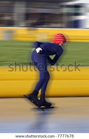 Speed ice skater in winter in the Netherlands - stock photo