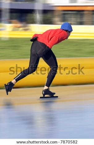 Speed ice skating in wintertime in the Netherlands - stock photo