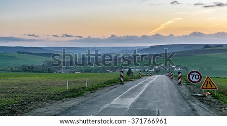 Speed limit 70 on small rural road in Champagne, near Epernay, France - stock photo