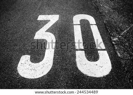 speed limit 30 painted on asphalt  - stock photo