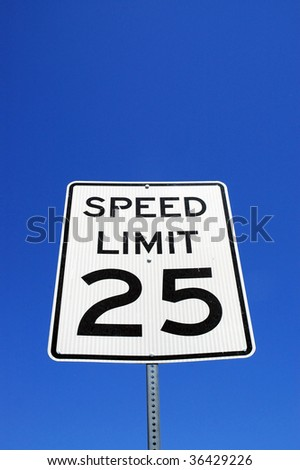 Speed limit sign against blue sky background room for copy space - stock photo