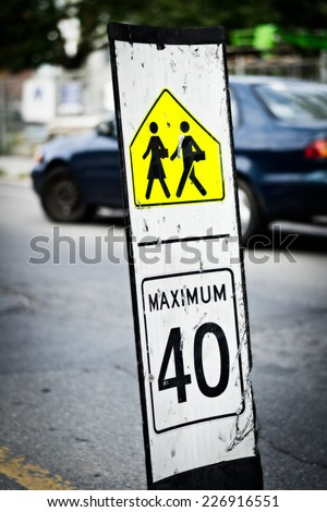 Speed limit sign at the middle of the route near school cross  - stock photo