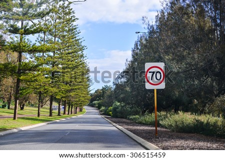 Speed 70 limit sign on a road - stock photo
