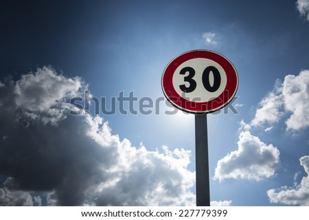 speed limit/speed limit sign 30 km/h - stock photo