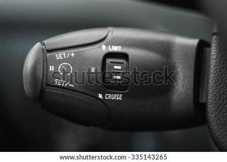 speed limitation and cruise control buttons on modern car - stock photo