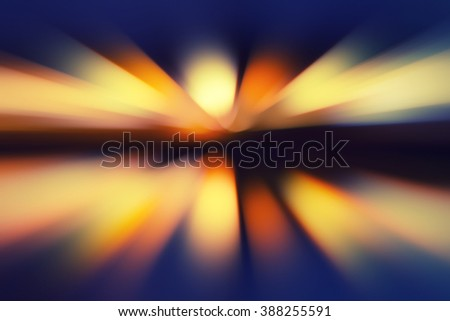 speed motion blur - city lights and reflections on a water - stock photo